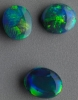 Black Opal set in green  Lightning Ridge